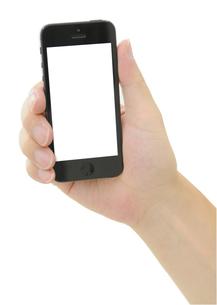 iPhoneと手の写真素材 [FYI00186495]