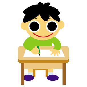 机で勉強する男の子の写真素材 [FYI00194134]