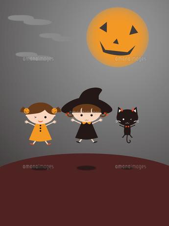 ハロウィン ジャンプする子供と黒猫の写真素材 [FYI00195551]