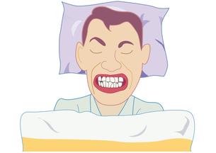 歯ぎしりをする男性の写真素材 [FYI00205521]