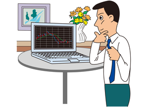 株価をチェックする個人投資家の写真素材 [FYI00205577]