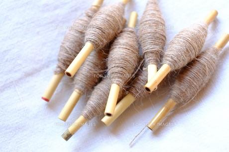 機織り作業の小管(こくだ)の写真素材 [FYI00208893]