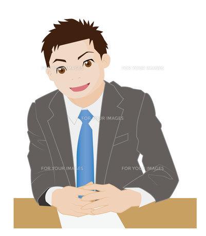 机の上で指を交差するビジネスマンの写真素材 [FYI00226660]