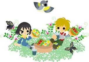 野原でサンドイッチを食べる男女の写真素材 [FYI00228117]