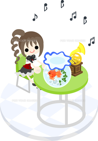 緑色のテーブルで、金魚と一緒に音楽を聴く少女の写真素材 [FYI00228134]
