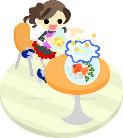 オレンジ色のテーブルに置かれた金魚鉢の金魚に餌を与える少女の写真素材 [FYI00228143]