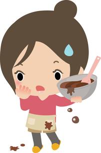 チョコレート作りに苦戦する若い女性の写真素材 [FYI00228343]