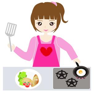 台所で料理をする女性の写真素材 [FYI00249185]