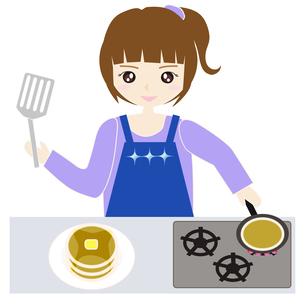 台所で料理をする女性の写真素材 [FYI00249195]