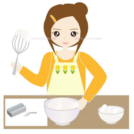台所でお菓子作りをする女性の写真素材 [FYI00249199]
