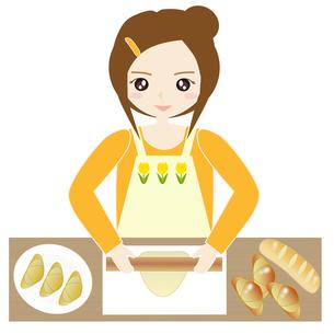 台所でパン作りをする女性の写真素材 [FYI00249201]