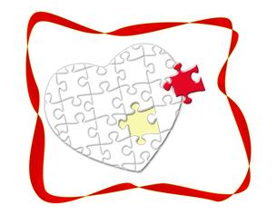 リボンとハート型のジグソーパズルの写真素材 [FYI00273650]