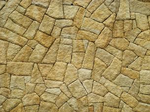 ベージュ色の細かな石垣のテクスチャの写真素材 [FYI00278318]