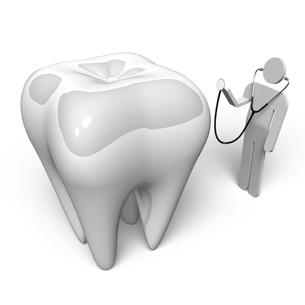 大きな歯と聴診器をもつ人の写真素材 [FYI00281719]