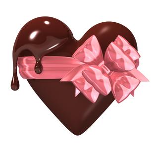 ピンクのリボンで結んだハート型のチョコレートの写真素材 [FYI00281956]