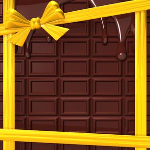 黄色いリボンと溶けた板チョコ 背景素材用の写真素材 [FYI00281971]