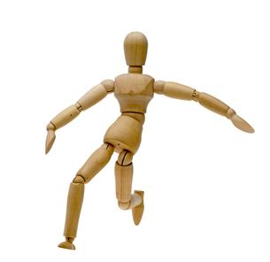 ボールを蹴るポーズをする人形の写真素材 [FYI00291442]