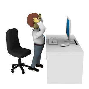 パソコンの前で頭を抱える男性の写真素材 [FYI00383372]