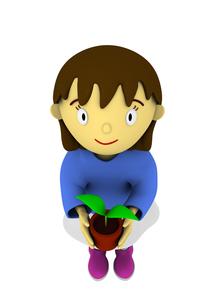植木鉢を持つ女の子の写真素材 [FYI00383375]