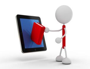 タブレットPCから本を取り出すの写真素材 [FYI00383498]