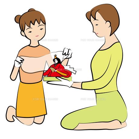 お雛さまを飾る母娘の写真素材 [FYI00405619]