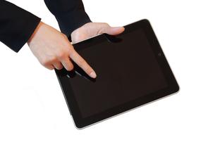 タブレットPCと女性の手の写真素材 [FYI00415553]