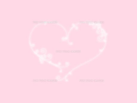光り輝くハートのラインとピンクの写真素材 [FYI00425182]