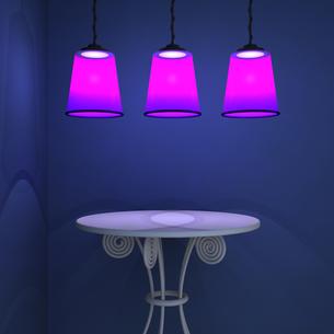 ライトのあたるテーブルの写真素材 [FYI00448483]