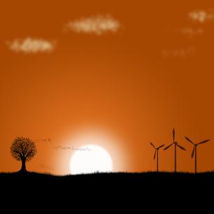 夕焼けの風力発電の写真素材 [FYI00448498]