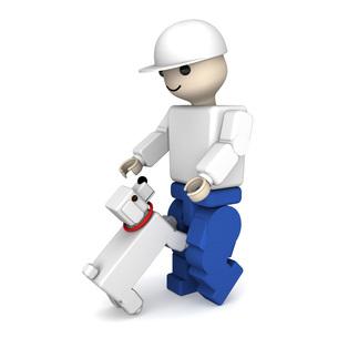 ブロック人形と犬の写真素材 [FYI00448510]