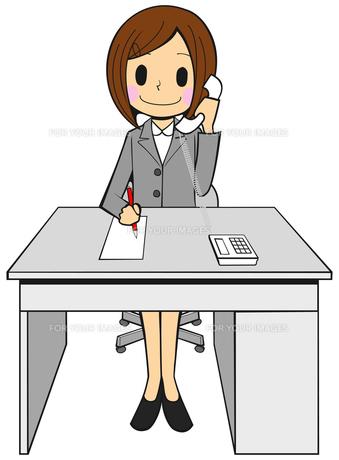 スーツ姿のOL 電話をする メモを取るの写真素材 [FYI00459578]