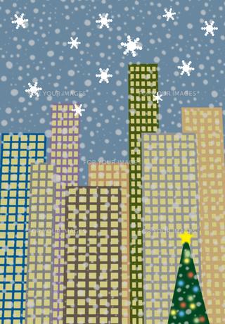 雪の降るクリスマスツリーがあるビル街の素材 [FYI00466258]