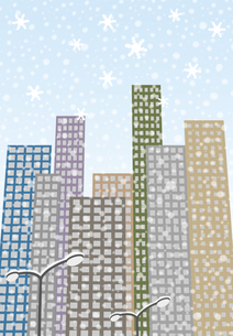 街灯に雪が積もるビル街の写真素材 [FYI00466264]
