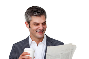Happy businessman reading and drinking coffeeの写真素材 [FYI00482110]