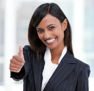 Cheerful businesswoman with a thumb up standingの素材 [FYI00482165]