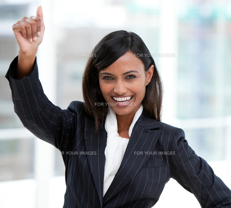 Successful businesswoman with a thumb up standingの素材 [FYI00482166]