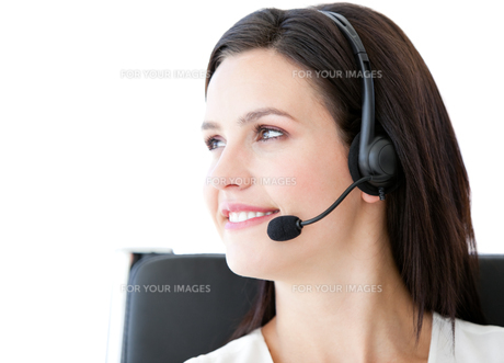 Attractive businesswoman with a headset onの写真素材 [FYI00482169]