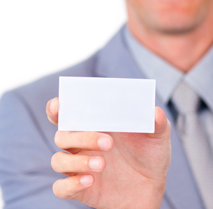 Charming businessman holding a white cardの写真素材 [FYI00482204]