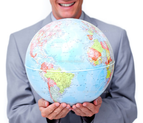 Close up of a businessman holding a terrestrial globeの写真素材 [FYI00482207]