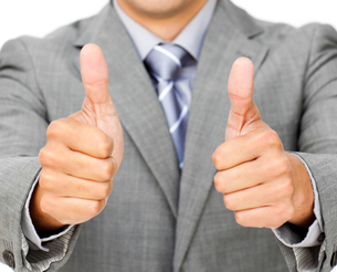 Close up of a businessman with thumbs upの写真素材 [FYI00482209]