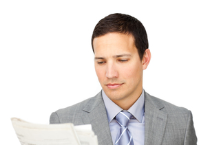 Concentrated businessman reading a newspaperの写真素材 [FYI00482210]