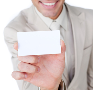 Close up of a businessman holding a white cardの素材 [FYI00482218]