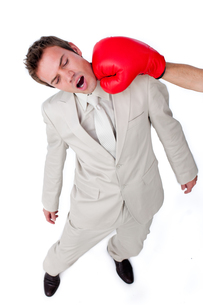 Positive businessman using boxing glovesの素材 [FYI00482222]