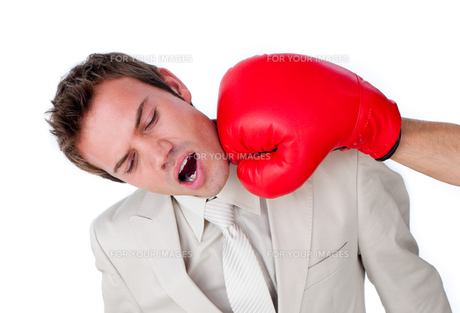 Male businessman using boxing glovesの素材 [FYI00482225]