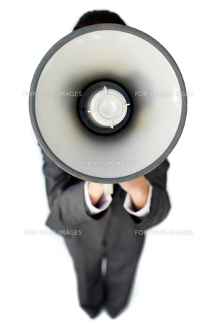 Businesswoman giving instructions with a megaphoneの写真素材 [FYI00482243]