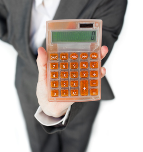 Close up of a businesswoman holding a calculatorの写真素材 [FYI00482244]