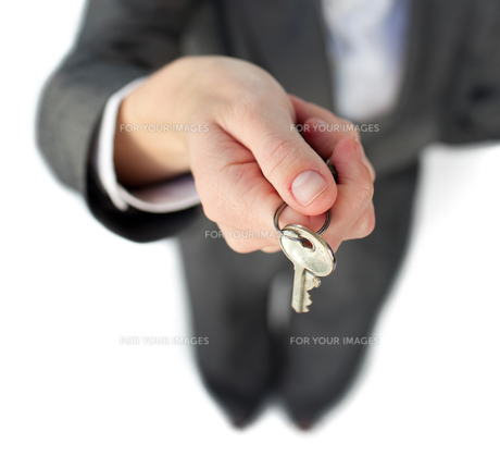 Close up of a businesswoman holding a keyの写真素材 [FYI00482246]