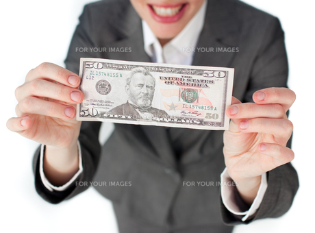 Close up of a businesswoman holding cashの写真素材 [FYI00482248]