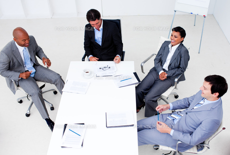 High angle of a smiling business team in a meetingの素材 [FYI00482258]