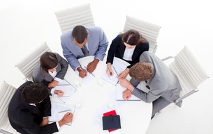 High angle of a diverse business group sitting around a conference tableの写真素材 [FYI00482272]